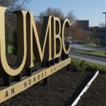 A photograph of the UMBC sign that is seen as students enter campus